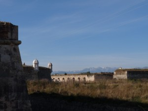 A small stretch of castle wall, with the Pyrenees beyond