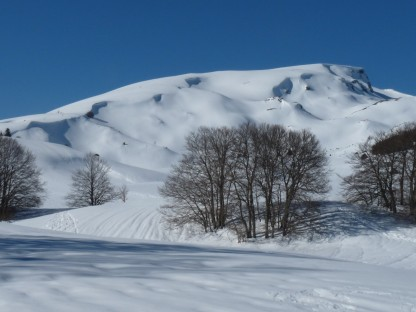 Snow-sculpted hillsides.