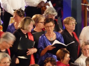 There we are, members of 5 different choirs, all in our different concert gear, squeezing together to begin singing.  That's me in the middle, in blue.