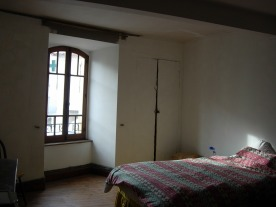 One of the bedrooms. We love those windows: so there's a positive.