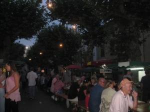 Evening market: crowds from the village and beyond sit down to eat together in the main street