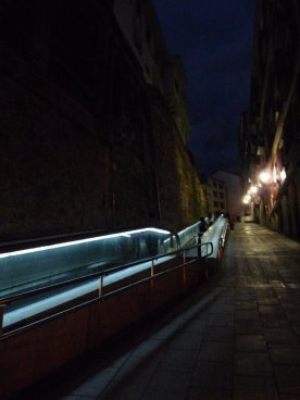 Our street at night, the travellator easing the upward journey