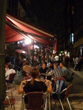 A busy bar, a busy street.