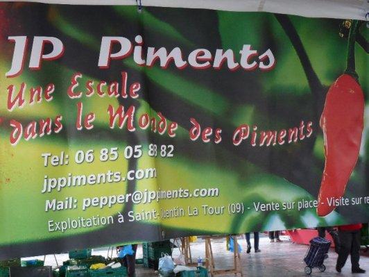 Banner above Mr. Chilli's stall