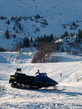 A snow buggy takes a break