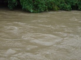 It's muddy, angry, fast-flowing, and rising steadily