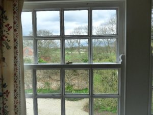 Looking out of the kitchen window towards the walled garden