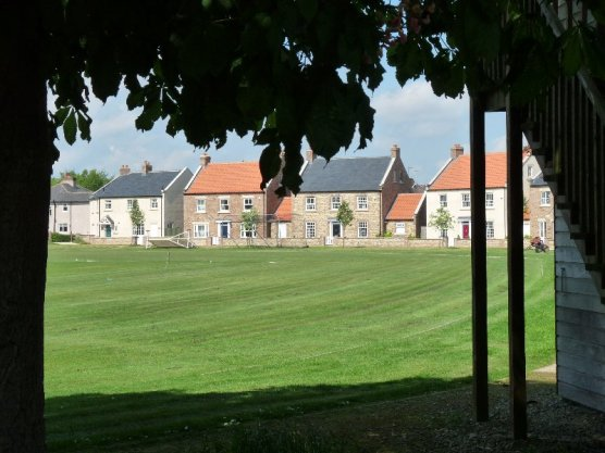A view of the village across the cricket pitch.