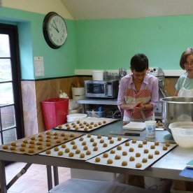 Two Margarets make Anzac biscuits.