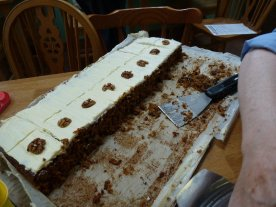 Malcolm's sliced half the carrot cake....