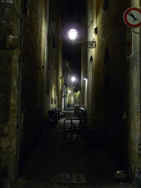 A narrow street leading to the Palazzo Pitti.