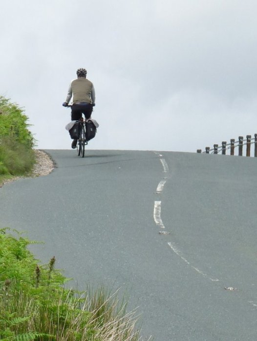 A cyclist rides the route.