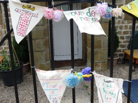 Younger children at the school decorated pennants.