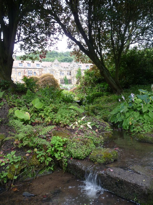 This is the Manor House as it appears today, viewed from the garden and fishpond.