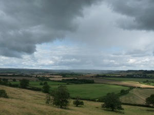 Look carefully.  You'll see rain falling in the plain  below.  But not on us.