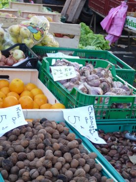Seasonal walnuts and chestnuts on a greengrocery stall