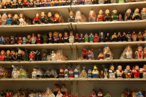 Caganers on a market stall.  Anybody you recognise here?