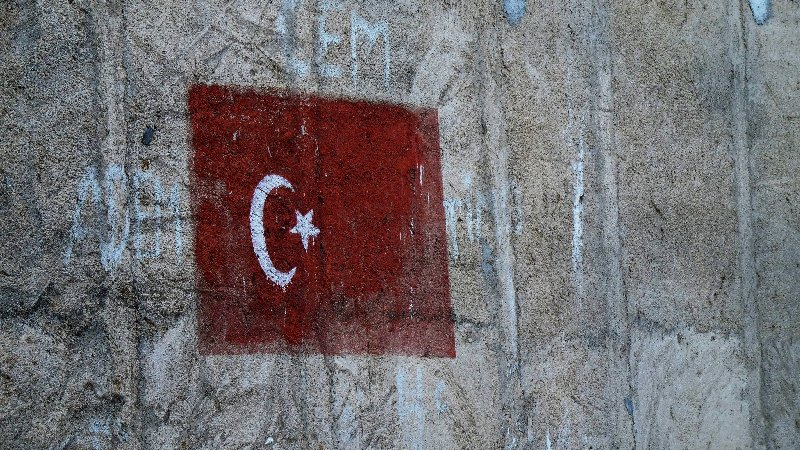 Turkish flag painted on the side of a building.