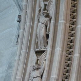 Angels rise above the chancel.