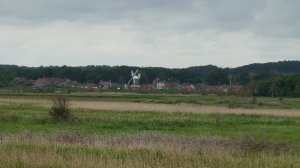 The village of Cley-next-the-sea, seen from the nature reserves on the marshland between the village and the sea.