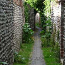 A narrow pathway in Cley-next-the-sea.