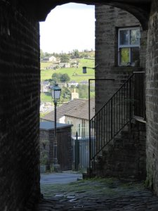 Peeking through a doorway in Haworth.