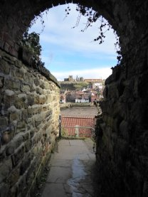 The abbey and church seen from a ginnel.
