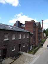 The extensive mill buildings.