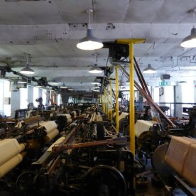 Banks of looms - the children crawled between them, keeping them functioning efficiently.