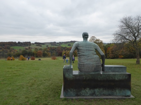 Henry Moore's 'Draped Seated Woman' looks down over the distant wooded lake.
