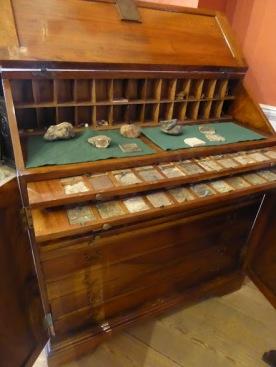 A desk full,of curiosities.