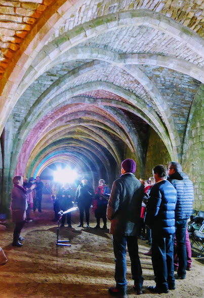 Choir in winter woollies.  It's cold in the cellarium.