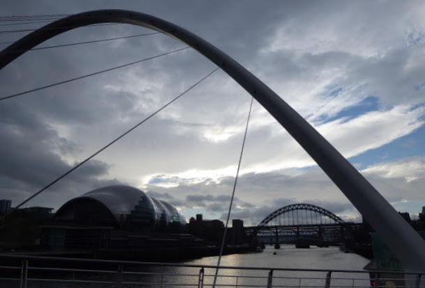 The Millennium Bridge, looking along the Tyne towards the Sage concert hall and the Tyne Bridge.