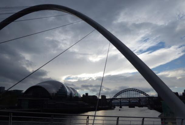 The Millennium Bridge, looking along the Tyne towards the Sage concert hall and the Tyne Bridge.