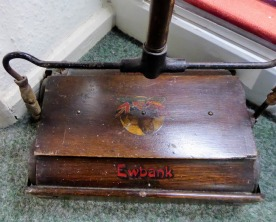 A Ewbank carpet sweeper.