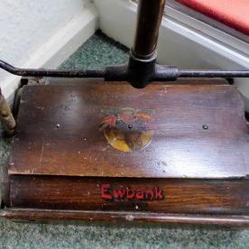 A Ewbank carpet sweeper.