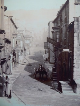 A photo in the museum collection of Pateley Bridge High Street in the very early twentieth century.