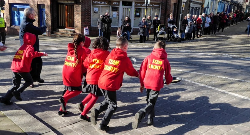 Children from Holy Trinity School tussle it out.