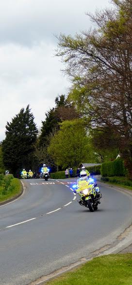 Police prepare the way.