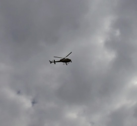 The helicopter's filming the action.