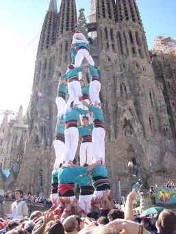 Castellers, or a human tower, in front of La Sagrada Familia (Wikimedia Commons)