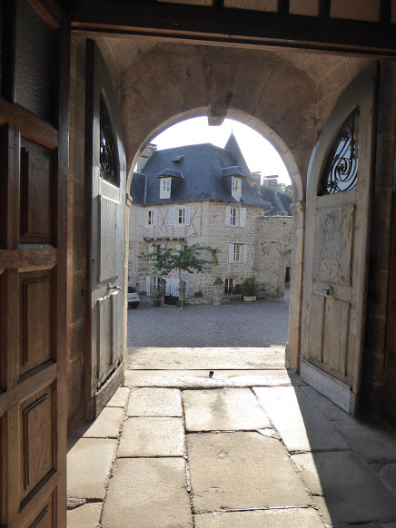 The town square, glimpsed through the doors of the church.