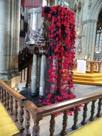 Poppies cascade from the pulpit in the Cathedral.