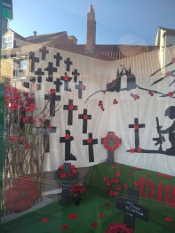 A window display in Calvert's Carpets, naming some of the fallen.