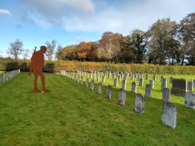 This tommy is facing the burial ground of the former soldiers who ended their days at peace in the British Legion home at Sharow, Ripon.