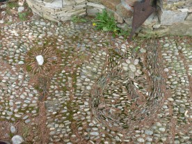 Traditional pebble paving in front of a village house.