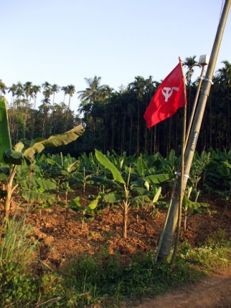 A farmer demonstrates his Communist allegiance