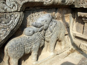 Trompe l'oeuil: Is the cow's head resting on the elephant, or is it the other way about?