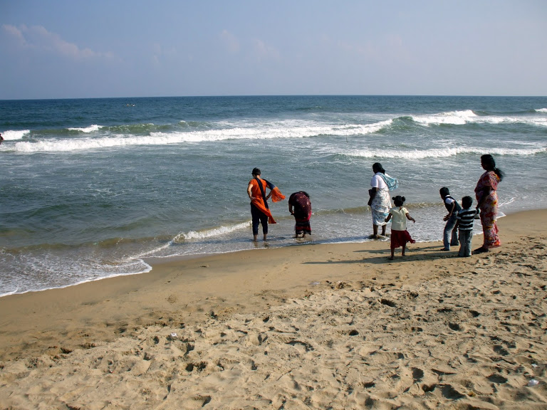 A family relaxing on the beach in Chennai