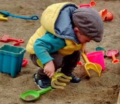 William, while he was still a toddler, plays with his bucket and spade.